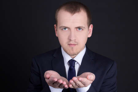 young business man presenting something on his hand photo