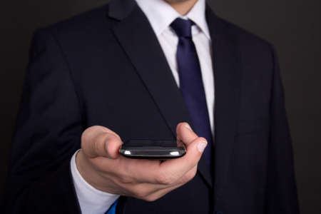 modern smart phone in young business man hand photo