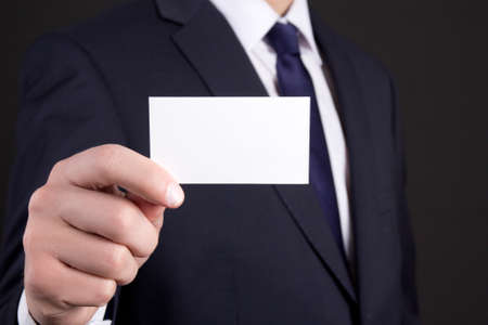 blank visiting card in business man hand photo