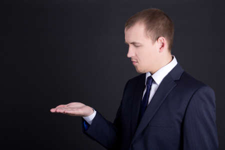 young business man showing something on his hand photo