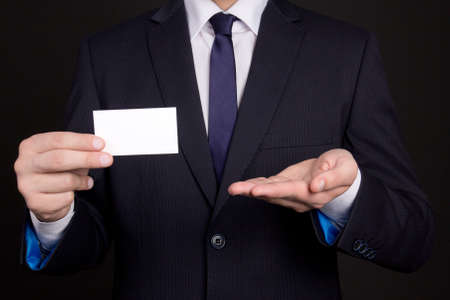 blank visiting card in young business man hand photo