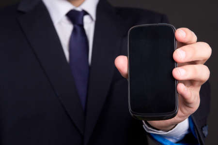 modern mobile phone with blank screen in business man hand photo