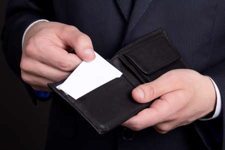 purse with blank visiting card in business man hand photo