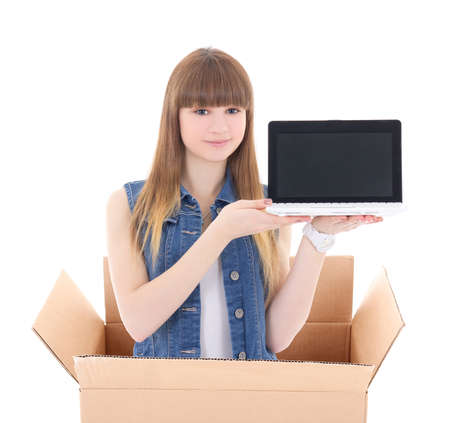 girl with laptop in cardboard box isolated on white background photo