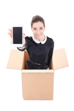 woman in cardboard box holding mobile phone with blank screen isolated on white background photo