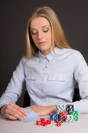 young attractive blond woman playing poker in casino photo