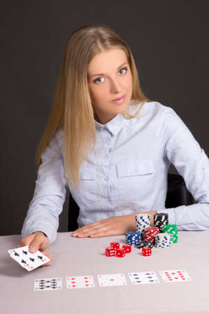 attractive blond girl playing poker in casino photo