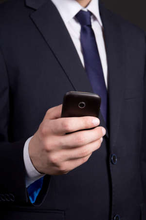 modern mobile phone in business man hand photo