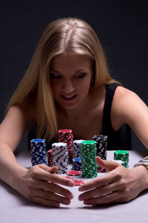 young beautiful blond woman with chips in casino photo