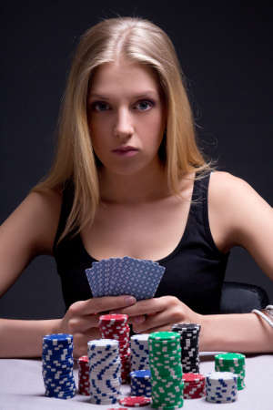 young woman in casino with cards and chips over grey photo