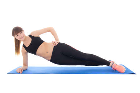 young woman doing fitness exercises on a mat isolated on white background photo