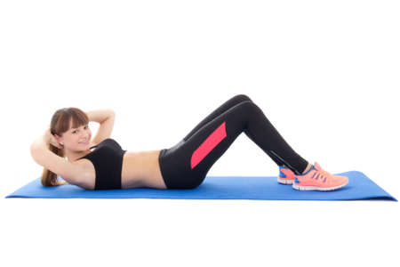 woman doing exercises for abdominal muscles isolated on white background photo