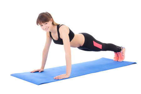 young woman doing push up exercise isolated on white background photo