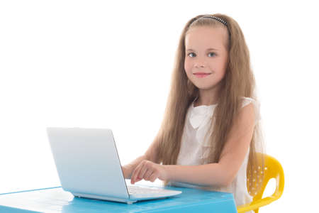 beautiful little girl using laptop isolated on white background photo