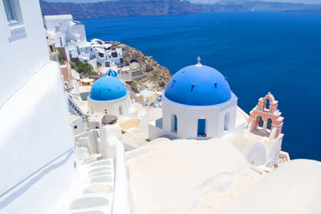 romantic and beautiful Santorini island with blue roofs in Greece photo