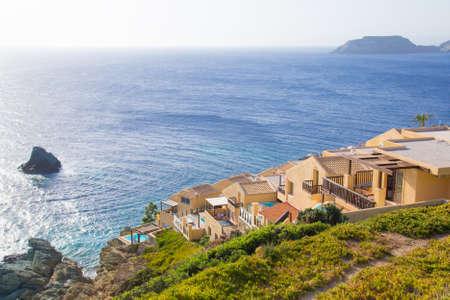 luxurious hotel on cliff near the Mediterranean sea photo
