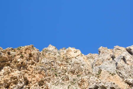 greece granite: view of rocky cliff over clean blue sky