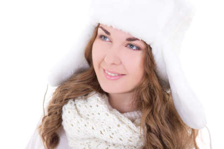 portrait of young beautiful woman in fur hat isolated on white background photo