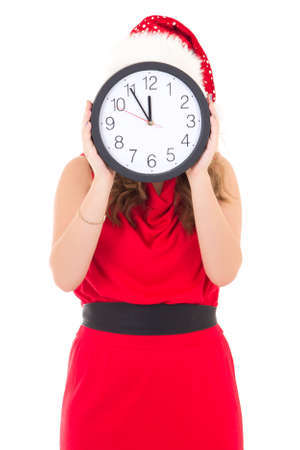 woman in santa hat with clock posing isolated on white background photo