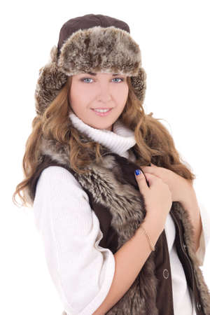 young beautiful woman in fur hat and vest isolated on white photo