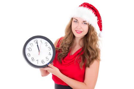 woman in santa hat with clock isolated on white background photo