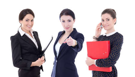 three young business women pointing at you isolated on white background photo