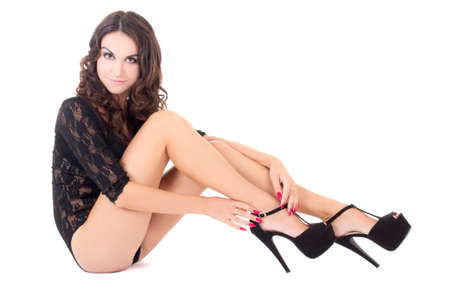 woman in lace lingerie and shoes on heels isolated on white background photo