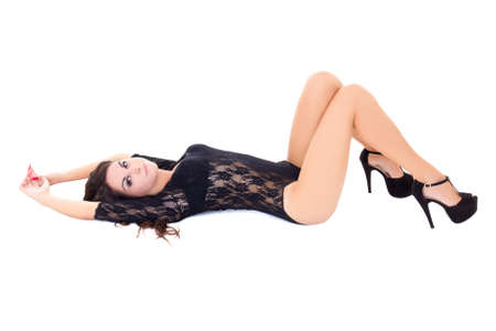 lying down on floor: beautiful woman in lace lingerie lying isolated on white background