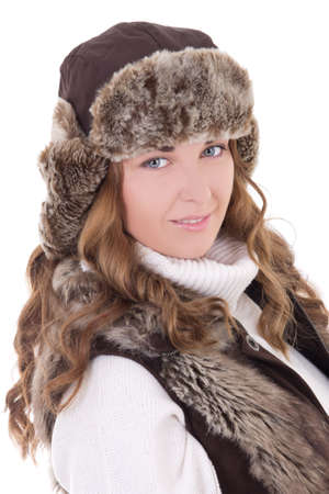 portrait of young beautiful woman in fur hat and vest isolated on white background photo