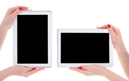horizontal and vertical view of modern tablet pc with empty copyspace screen in female hands isolated on white background photo