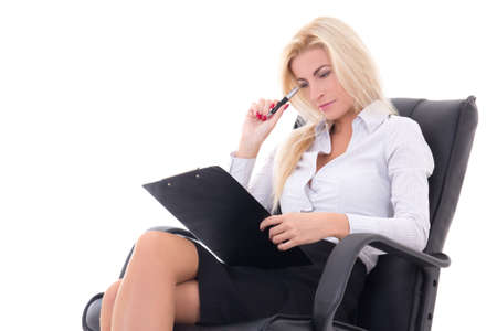 sexy business woman sitting on office chair with clipboard and pen isolated on white background photo