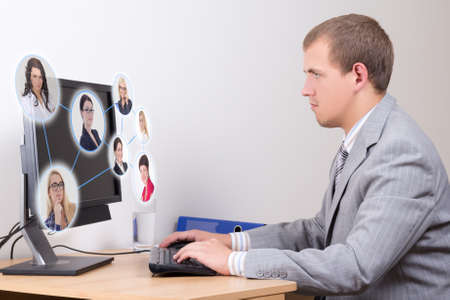 social network concept - young business man working with pc in office photo