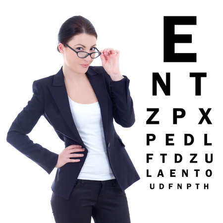 young attractive business woman in eyeglasses and eye test chart isolated on white background photo