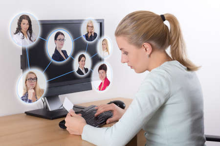 job search concept - woman using personal computer at home photo