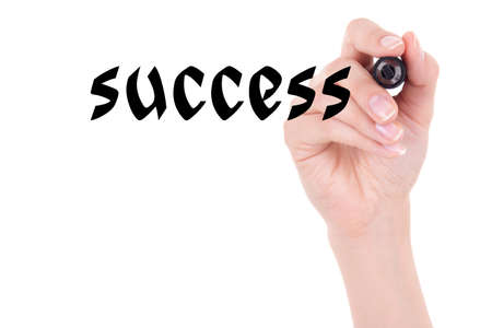success concept - woman hand holding marker and writing isolated on white background photo