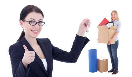moving day concept - business woman with metal key and girl with box isolated on white  background photo