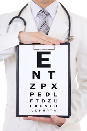 clipboars with eye test chart in doctors hands photo