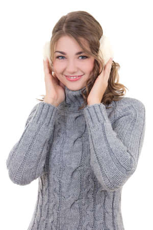 muff: portrait of happy attractive woman in woolen sweater and muffs isolated on white background
