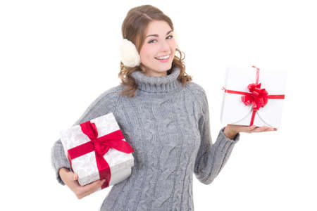 happy attractive woman in woolen sweater and muffs with christmas presents isolated on white background photo