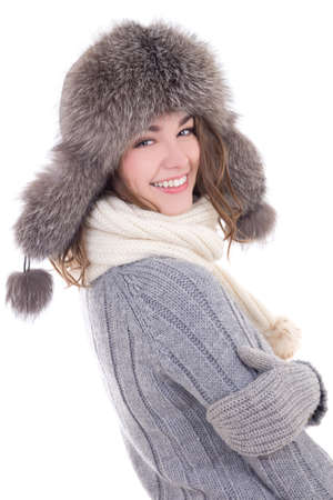 happy young beautiful woman in woolen sweater and fur hat isolated on white background photo