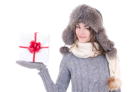 happy young beautiful woman in winter clothes with christmas present isolated on white background photo