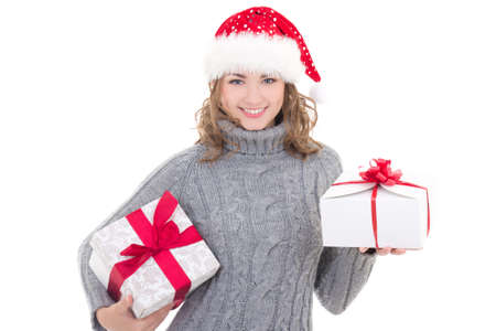 cute teen girl: young beautiful woman in winter clothes and santa hat with christmas presents isolated on white background