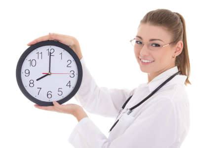 happy young female doctor with office clock isolated on white background photo
