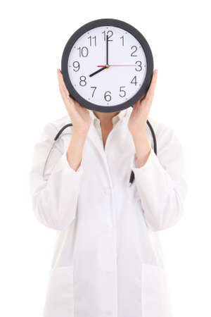 young female doctor with office clock covering her face isolated on white background photo