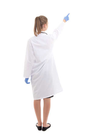 back view of young woman doctor pointing at something isolated on white background photo