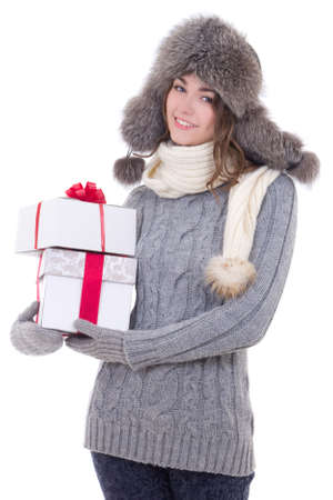 young beautiful woman in winter clothes with christmas presents isolated on white background photo