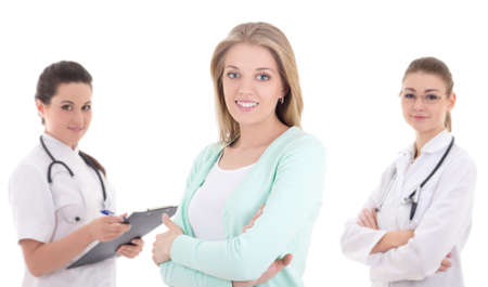 young female patient and two doctors isolated on white background photo
