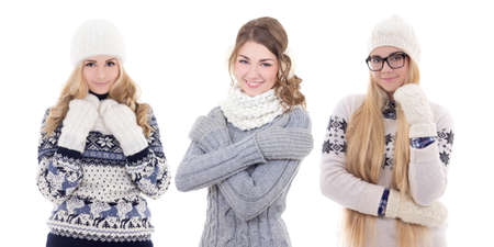 three young cute women in warm winter clothes isolated on white background photo