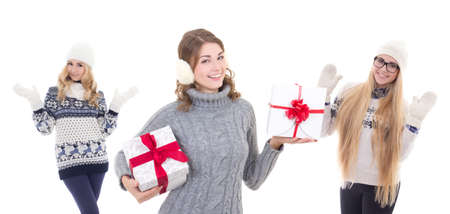 three happy attractive women in winter clothes with christmas presents isolated on white background photo