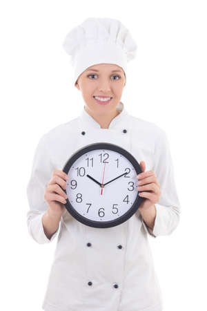 young woman chef in uniform holding office clock isolated on white background photo